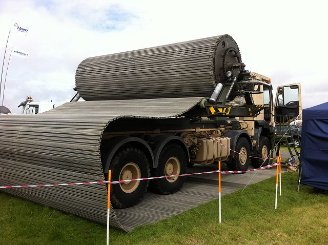 British Company FAUN Trackway presents at MSPO 2015 defense industry exhibition in Kielce, Poland its flagship product, the Heavy Ground Mobility System (HGMS). Designed for use in both military and disaster relief operations, the HGMS is a temporary modular roadway that enables the rapid movement of vehicles over challenging terrain.