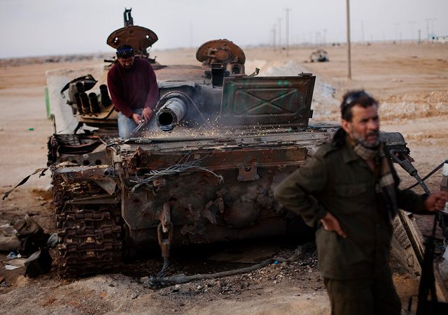 Civilian vehicles are also transformed into armoured vehicle, armour plates are fitted around the vehicle to increase the protection against anti-tank rocket and small arms firing. Libyan rebel fighter's cuts metal from destroyed tanks to be used to create armour for light rebel vehicles.