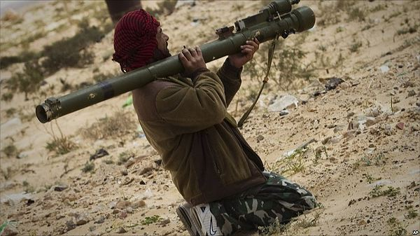 Instead, the rebel forces appear to have been largely volunteers, often with little military expertise. On this picture the Libyan rebel uses an anti-aircraft portable missile SA-7 without the launching mecanism as an anti-tank rocket launcher.