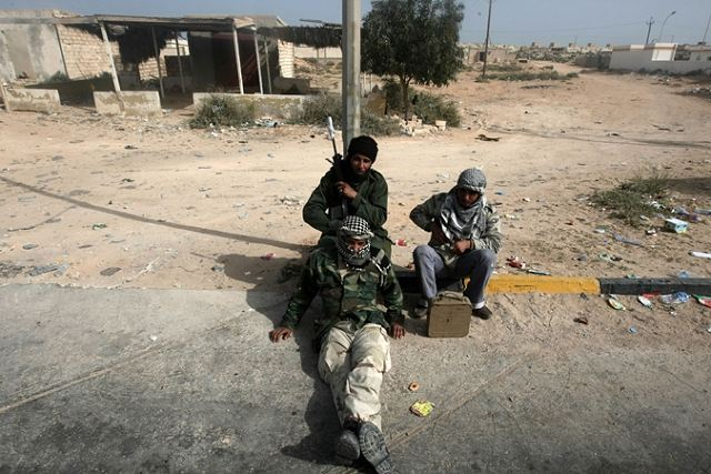 Libyan rebels fled in headlong retreat against the arms and tactics of Muammar Gaddafi's troops Wednesday. This only exposes the insurgents' weakness without Western air strikes to tip the scales in their favor.