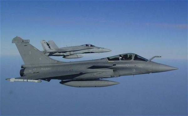 "The first firing of the French air forces in Libya aimed at a ""unspecified vehicle"", announced the `French staff HQ of the armies."