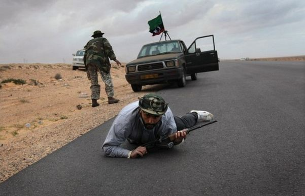 Libyan leader Moammar Gadhafi's forces appeared to be advancing Wednesday Match 09, 2011, on Ras Lanuf, using planes and heavy artillery in an effort to retake the eastern oil city.