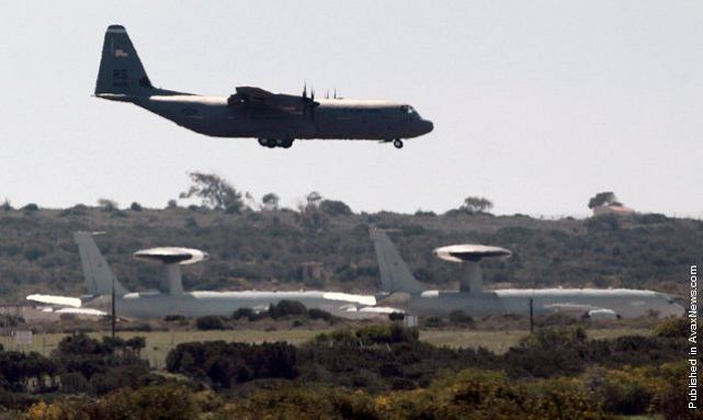 Warplanes and military transporters have begun arriving at Britain's Akrotiri airbase on Cyprus, less than 100 miles from the Syrian coast, in a sign of increasing preparations for a military strike against the Assad regime in Syria.
