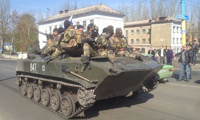 Pro-Russian armed separatists have seized five armoured personnel carriers BTR-D and a tank from the Ukrainian army, which they then drove in a victory lap through the centre of Kramatorsk in Ukraine's east, where government forces are attempting to wrest back control of the city.
